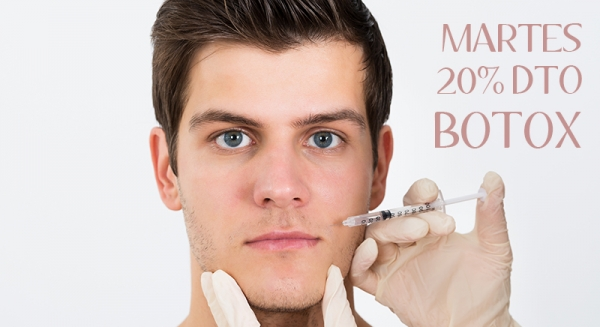 Close-up Of Person Hands Injecting Syringe On Young Man Face